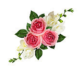 Festive arrangement with pink roses and freesia flowers