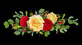 Red and yellow rose flowers with eucalyptus leaves in a line arrangement