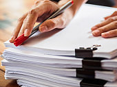 woman hand writing on stack of paper. business and education  concept
