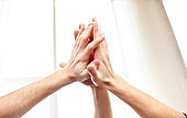close up of hands making high five gesture
