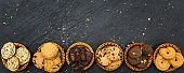 Top view different cookies on table top, Flat lay of various cookies on black stone for background, Prepared cookies food buffet on table for serve