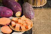 Preparation sweet potato slice for cooking, Purple raw potatoes for healthy eating and healthy lifestyle, Nutrient purple raw food and high antioxidant