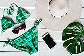 Green bikini flat lay summer vacations concept