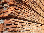 long wall made with many bricks