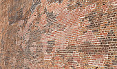 Background of thousands of red bricks of a large wall