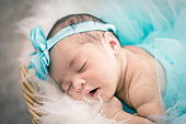 Close-up shot,cute and adorable newborn baby with costume sleeping.New life and parenting concept.