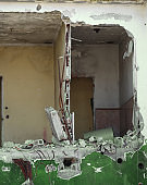 completely destroyed house with broken walls