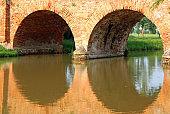 bridge made of bricks with arches