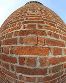 tower of the old aqueduct made with bricks photographed with fis