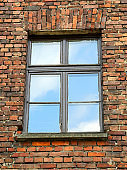 brick wall with a rectangular window