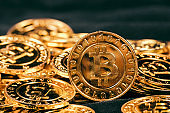 worldwide cryptocurrency, huge stack physical version of golden Bitcoin