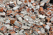 bricks with mortar and cement of a destroyed house
