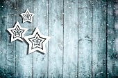New Year stars on wooden background