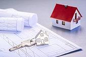 House as a keychain on blueprints