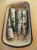 Preparing mackerel fish in the marinade, for frying