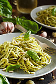 Spaghetti pasta with pesto sauce