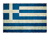 Flag of Greece on grunge postage stamp background isolated