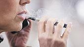 Senior woman smoking electronic cigarette