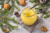 Homemade lemon curd in glass jars on the table. Concept Christmas