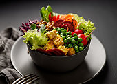 Buddha bowl,  healthy and nutritious salad with a variety of vegetables, nuts and tofu cheese