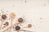 spices and herbs on kitchen wooden table background with copy space for text. food, cooking and restaurant concept. flat lay composition, top view