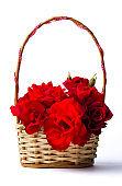 Red roses bouquet in a wciker basket