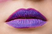 cropped image of female purple lips