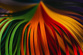 close up of green, orange and red quilling paper curves