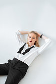 beautiful fashionable blonde girl posing in formal wear isolated on grey