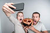 father and son with halloween pumpkin