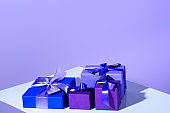 purple and violet gift boxes with bows, ultra violet trend