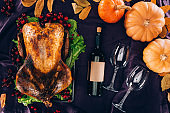 baked turkey with wine bottle and glasses