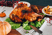 Baked turkey on a wooden table