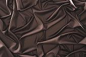 full frame of folded dark silk cloth as background