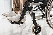 close up on male legs in wheelchair in nursing home