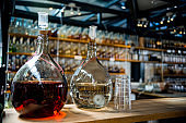 Selective focus of jugs with different alcohol drinks on bar counter