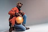 man holding basketball ball on his knee