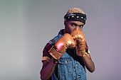 man in golden boxing gloves looking at camera