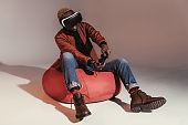 man in virtual reality headset playing with joystick