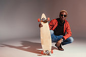 skateboarder sitting and holding longboard