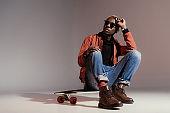 skateboarder sitting on longboard