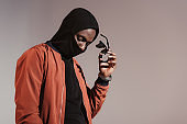 man wearing hood with face mask
