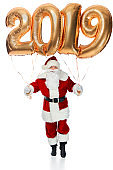 santa claus holding new year 2019 golden balloons isolated on white