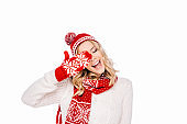happy young woman in red hat, scarf and mitten laughing isolated on white