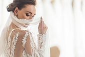 Stylish bride in lace dress in wedding salon