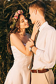 beautiful happy young tender wedding couple able to kiss