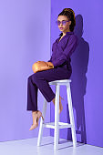beautiful mulatto girl in boxing glove sitting on stool, ultra violet trend of 2018 year