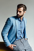 fashionable handsome man in blue trendy suit