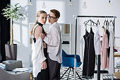 fashion designers lesbian couple taking off clothes at office