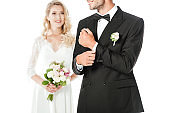 cropped shot of beautiful young bride and groom isolated on white